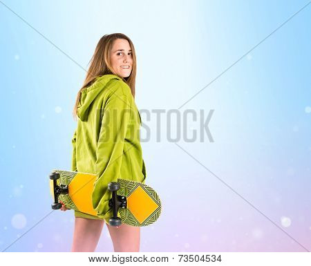 Skater With Green Sweatshirt Over Gloss Background