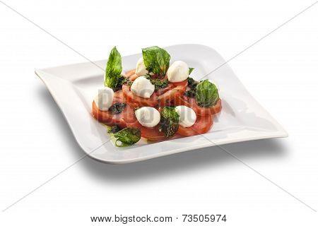 Artistically Arranged Tomato Salad With Mozzarella Garnished With Basil