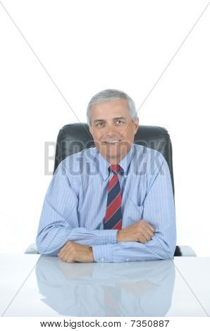 Businessman Seated At Desk