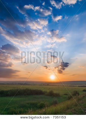 Sunset And Meadow