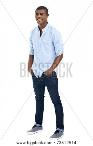 confident young black african man standing with hands in pockets in smart casual clothing isolated on white