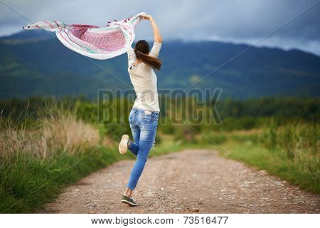Portrait Of A Young Woman Outdoor Dancing
