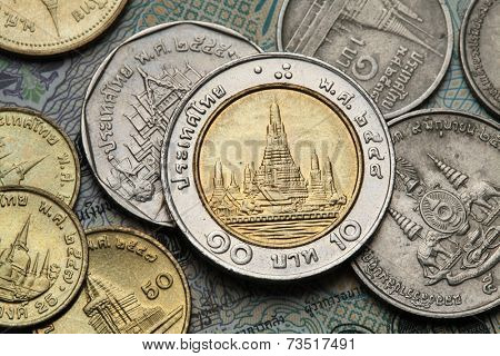 Coins of Thailand. Wat Arun Temple in Bangkok, Thailand, depicted in the Thai ten baht coin.