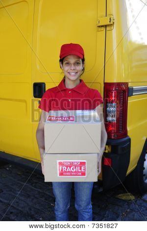 Delivery Courier Or Postman Delivering Cardboards