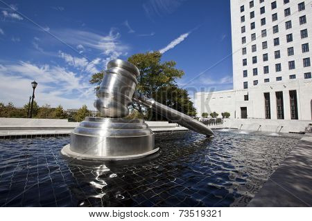 COLUMBUS, OHIO-SEPTEMBER 27, 2014: The Gavel Sculpture in downtown Columbus sits in the reflecting pool alongside of the Supreme Court of Ohio building.