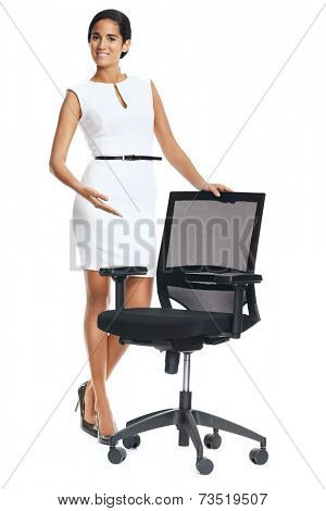 young woman shows vacant seat for recruitment concept isolated on white