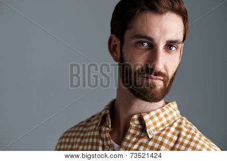 Portrait of young hipster man with ginger hair and beard