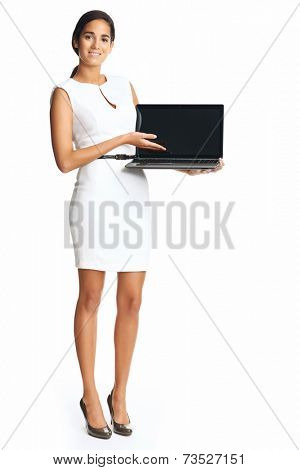 businesswoman holding laptop for presentation in studio smiling and happy