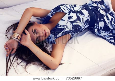 Pretty Brunette In Elegant Dress Relaxing On Beach Divan