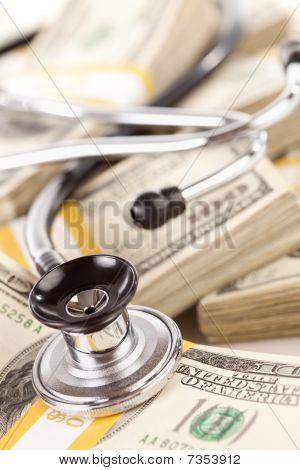 Stethoscope Laying On Stacks Of Money