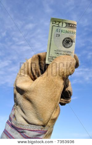 Worker Holding A Twenty Dollar Bill