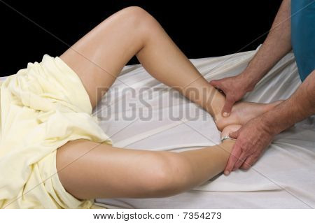 Young Woman Getting Massage Therepy From A Massuer