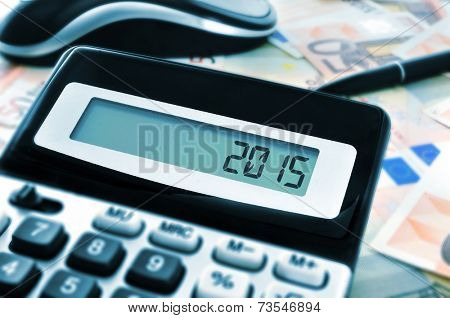 the number 2015, as the new year, on the display of a calculator