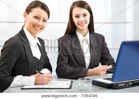 Portrait of two young confident business ladies