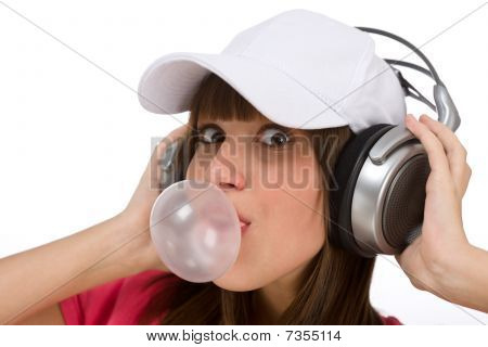 Happy Teenager With Bubble Gum And Headphones