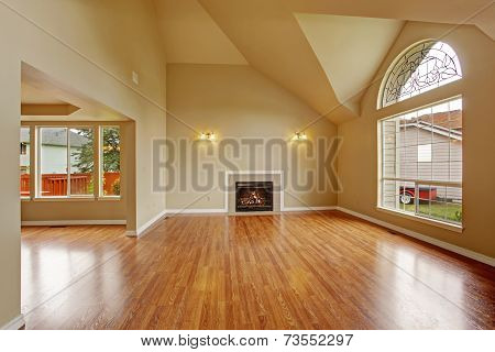 Empty Living Room With High Ceiling And Big Arch Window