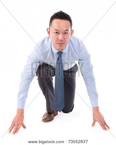 Asian business male on starting line of a race, front view full length isolated over white background.