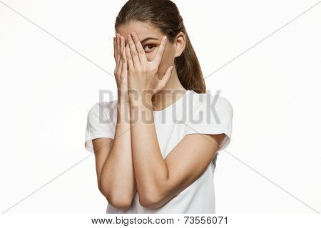 Girl covering face with hands, hiding face with hands