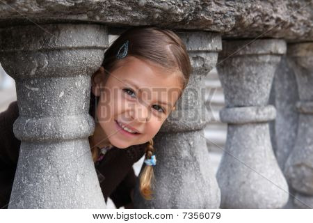 Girl playing peek a boo