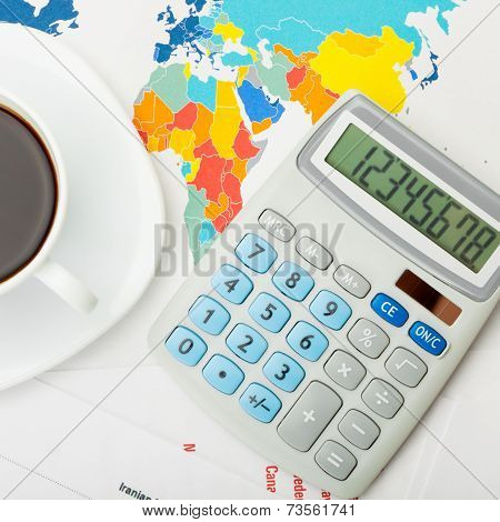 Coffee Cup Over World Map And Financial Documents - View From Top