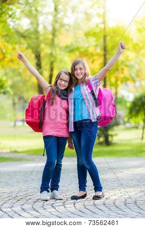 Happy Teenage Schoolgirls With Schoolbag