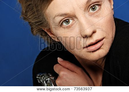 Surpriced mature senior woman (wrinkles were made with make-up)