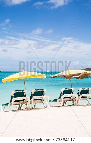 Green Chaise Lounges On Beach