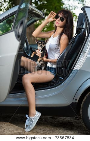 Young Woman Posing With A Pet
