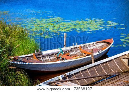 Two Old Fishing Wooden Rowboats