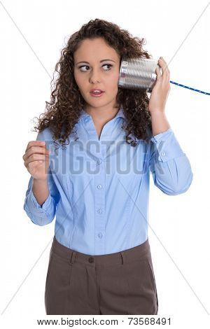 Isolated young businesswoman with tin can phone serious and stunned.