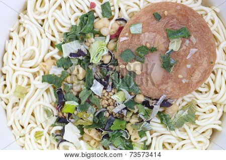 Top view of Uncooked instant noodles and toping