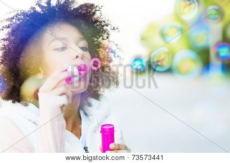 Afro woman blowing soap bubbles