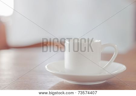 Mini White Coffee Cup On Wooden Table
