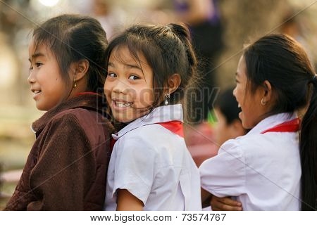 SAYABURY, LAOS, FEBRUARY 16, 2012: Joyful unidentified little girls posing in the schoolyard during the Elefantasia festival in Sayaboury, Laos