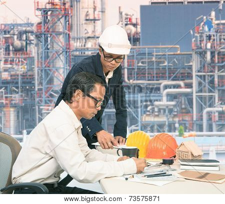 Two of same model Engineer Working On Table