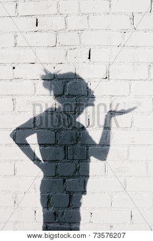 Pretty Girl Sending An Air Kiss Around On The Brick Wall Background