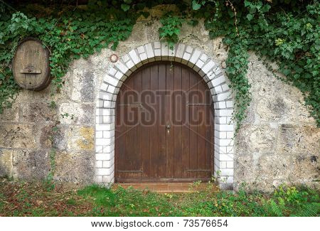 Round wooden gate of a stock of wine