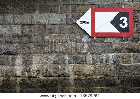 Striking Wall with arrow sign