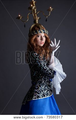 Beautiful dancer with candelabra on her head