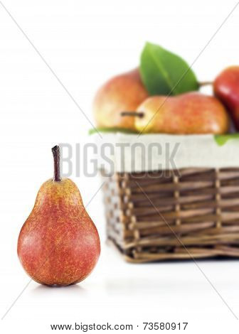 Pear with a basket in the background