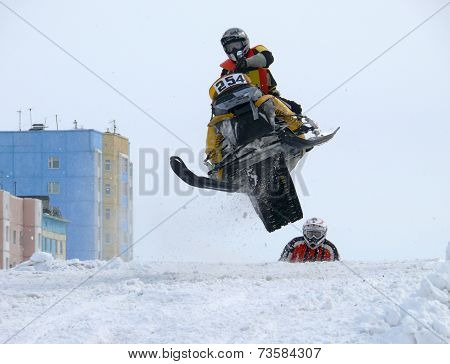 Nadim, Russia - April 19, 2009.: Snoukross. Vadim Vasuhin Jump In With Springboard On Snowmobile Dur