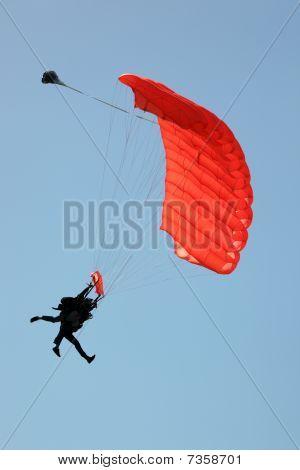 Silhouette Of Tandem Sky Divers Landing