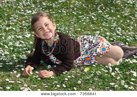 Girl in field of daisies