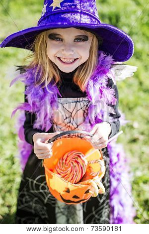 Trick or treat. Halloween character: beautiful little witch