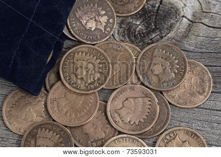 Bag Of Vintage Coins On Old Wood
