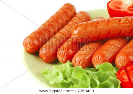 Grilled Sausages On Green Dish