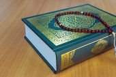 picture of quran  - The quran on the wooden table background - JPG