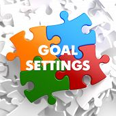 stock photo of goal setting  - Goal Settings on Multicolor Puzzle on White Background - JPG