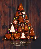 stock photo of christmas spices  - Hanging Gingerbread Man Christmas Cookies for Xmas Decoration - JPG