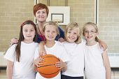 picture of physical education  - Portrait Of Teacher With Girls School Basketball Team